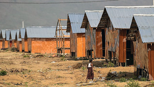 A man passes through the construction site of the Hla Pho Khaung processing camp for returning Rohingya refugees near the Bangladesh border in Maungdaw district, western Myanmar's Rakhine state, April 24, 2018.