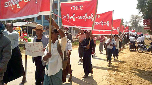 Myanmar protesters demand compensation for land confiscated by the Chinese and Myanmar operators of a pipeline project in Ann township, western Myanmar's Rakhine state, March 22, 2018.