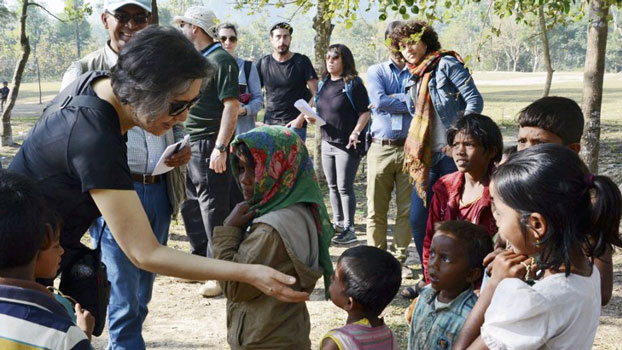 Yanghee Lee (L), the United Nation's special rapporteur on the situation of human rights in Myanmar, visits a Rohingya refugee camp in Cox's Bazar district, southeastern Bangladesh, Jan. 20, 2018.