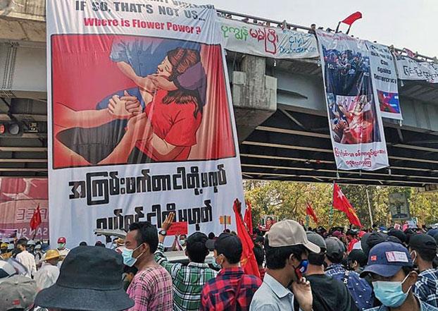 myanmar-protesters-banners-overpass-yangon-feb10-2021.jpg