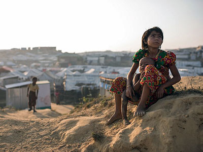 A Rohingya child refugee from Myanmar sits with a baby at the Kutupalong refugee camp in southeastern Bangladesh's Cox's Bazar district, Nov. 27, 2017.