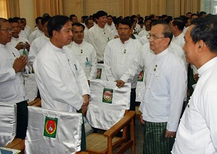 Burmese president Thein Sein (second from right) greets USDP members at a party conference in Naypyidaw, Oct. 14, 2012.