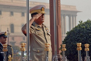 Nyan Tun salutes during a ceremonial reception in New Delhi, February 10, 2010.