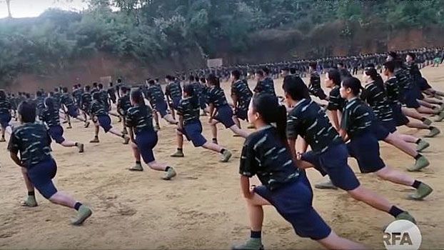 Female Arakan Army recruits exercise as part of their training regimen in northern Myanmar's Kachin state in an undated photo.
