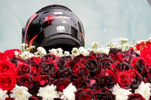 The bullet-pierced motorbike helmet of slain protester Mya Thwe Thwe Khine, adorns her funeral floral display in Naypyidaw, Feb. 21, 2021.