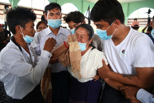 The mother of Mya Thwe Thwe Khine, the first protester to die in demonstrations against the Myanmar military coup, mourns her daughter in Naypyidaw, Feb. 21, 2021.