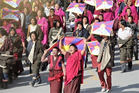 Buddhist monks march in Xiahe, Gansu Province on March 14, 2008. AFP