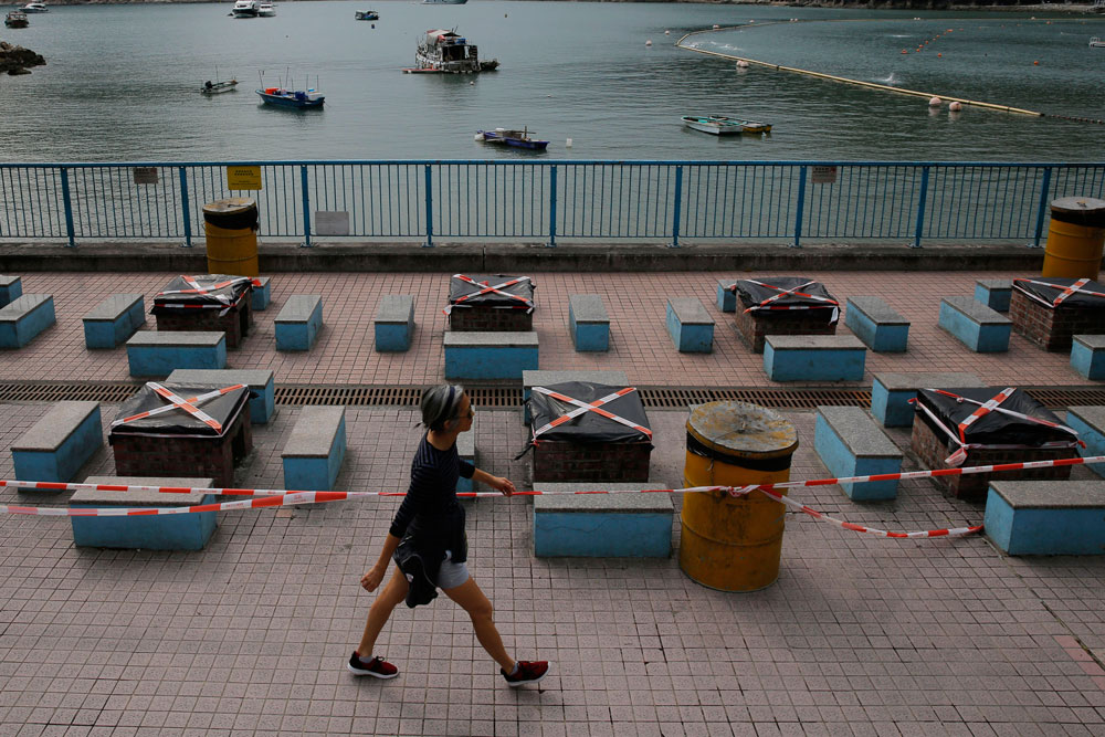 Barbecue pits are closed at a beach as a social gathering deterrent to help curb the spread of the coronavirus, in Hong Kong, Wednesday, April 8, 2020. (AP Photo/Kin Cheung)
