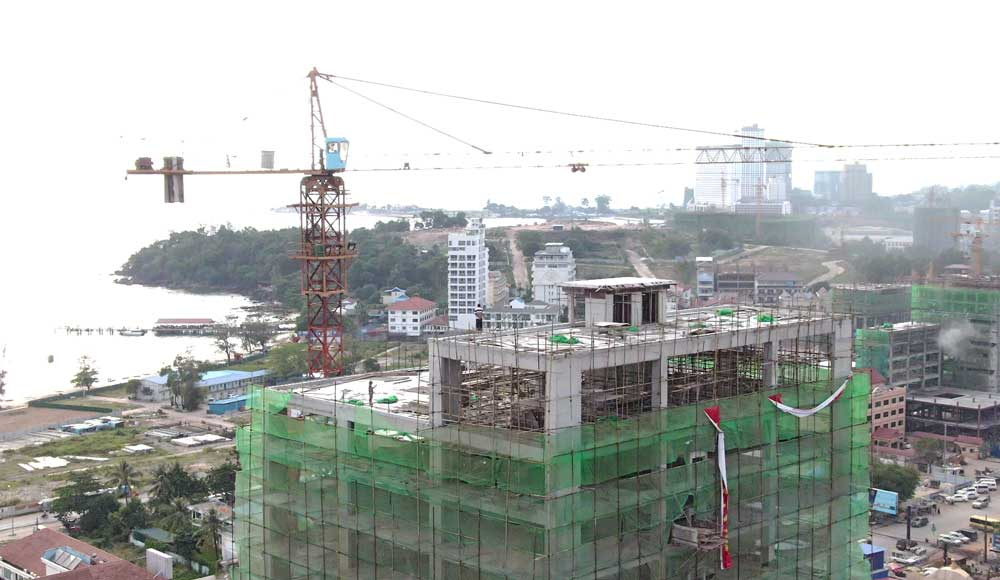 Chinese construction sites are ever present in Sihanoukville, providing employment for Cambodians and a large number of foreign workers too. Photo: RFA