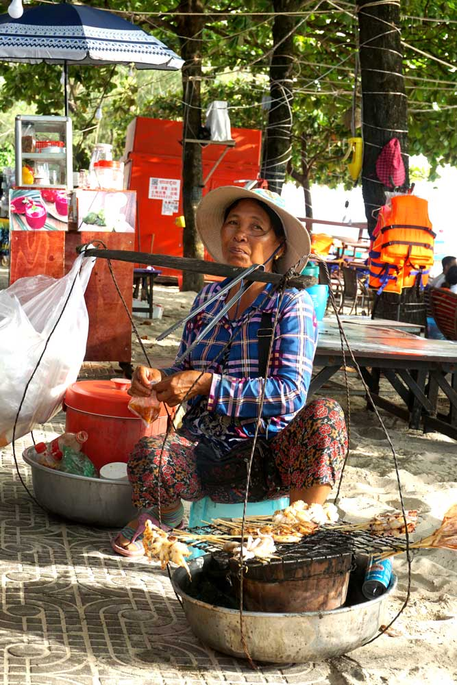 A beach side vendor. Many local workers have struggled in the new Chinese-led economy. Photo: RFA