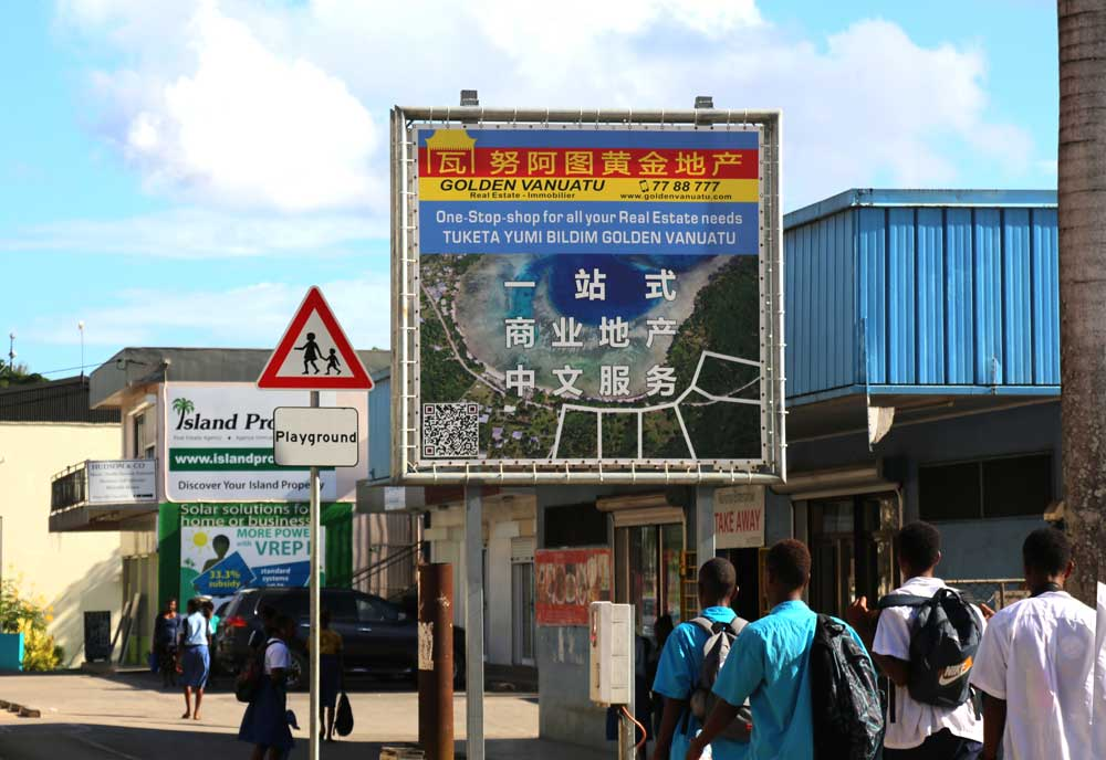 A real estate sign in Port Vila. These signs are commonplace in the capital and tailor-made for Chinese investors. Photo: RFA