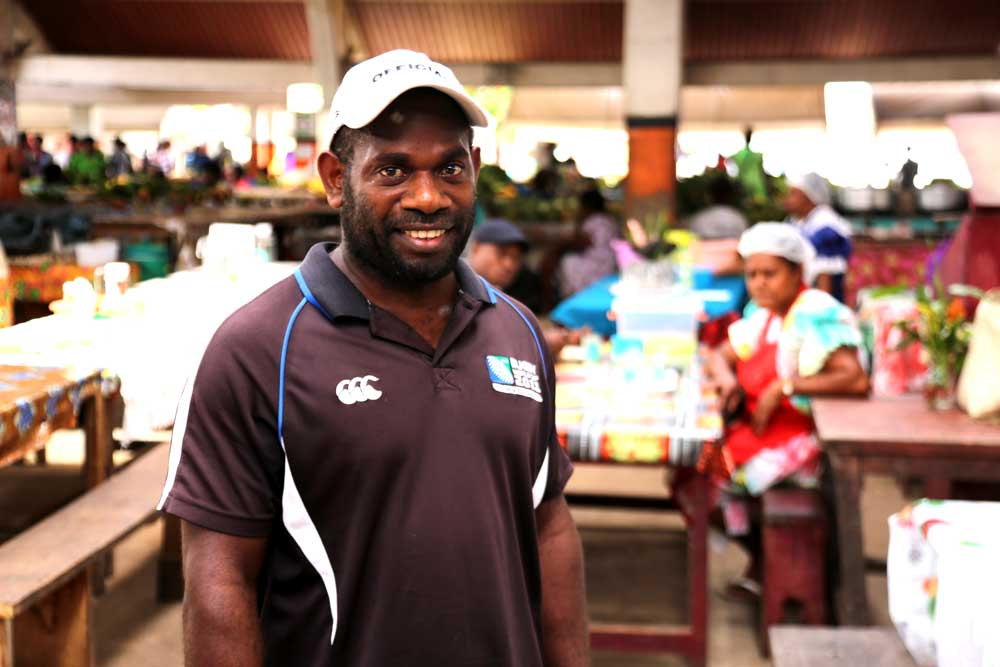 Reuben is a local business owner at Port Vila markets. Local businesses are becoming increasingly rare in Port Vila where increasingly shops and restaurants are Chinese-owned. Photo: RFA