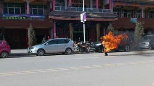 Dorje Rinchen sets himself on fire along the main road in Labrang, Oct. 23, 2012.