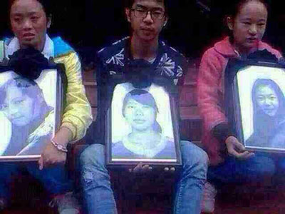 Friends hold photos of Tibetan students mowed down by car, Sept. 26, 2014. Credit: RFA listener