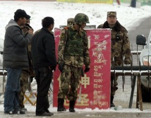 Police stand guard at a roadblock in Ngaba county, a Tibetan-populated area of Sichuan province, March 11, 2012.