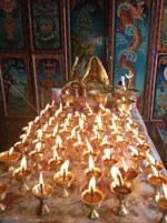 Butter lamps offered in prayer, Feb. 25, 2013.