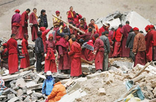 Tibetan Buddhist monks search for earthquake victims in Yushu county, in northwest China's Qinghai province, April 16, 2010.