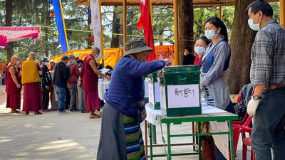 Tibetans line up to cast their votes in Dharamsala, India, April 11, 2021.
