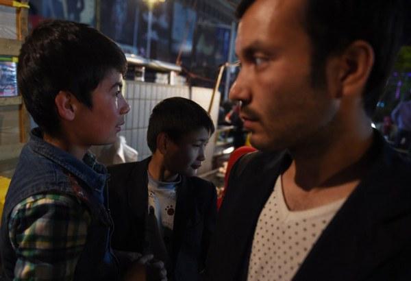 china-xinjiang-uyghurs-hotan-night-market-apr16-2015.jpg