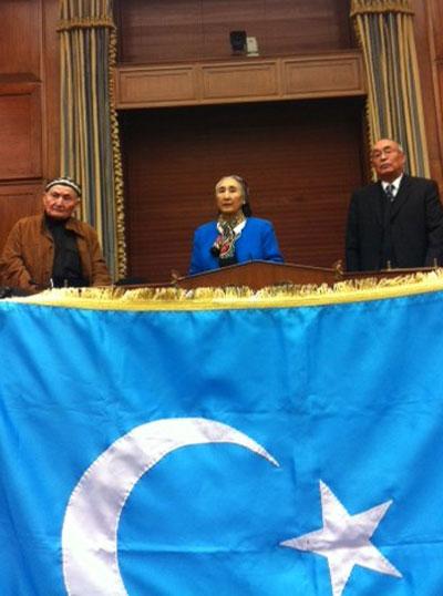 Rebiya Kadeer (C) speaks at a commemoration of the anniversary of the East Turkestan Republics in Washington, Nov. 12, 2013. Credit: RFA