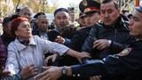 uyghur-kazakh-police-protesters-almaty-oct-2019.jpg
