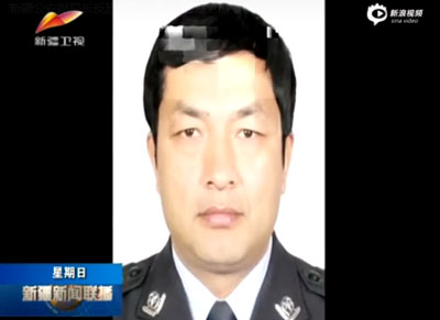 A screen grab from a state media report describing Memet Toxtiniyaz's role in a manhunt for suspects of the coal mine attack. Credit: Sina Video