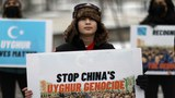 People rally to encourage Canada to label China's treatment of its Uyghur population as genocide, outside the Canadian Embassy in Washington, Feb. 19, 2021.