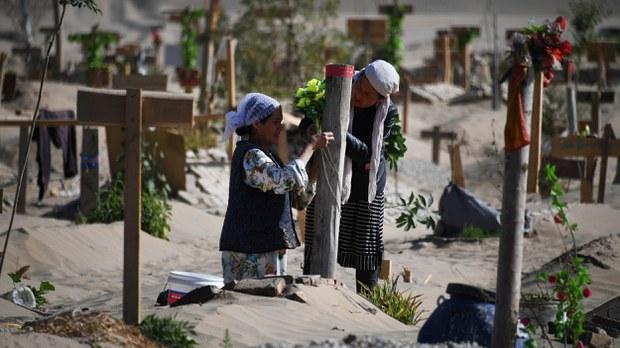 uyghur-women-cemetery-hotan-may-2019-crop.jpg