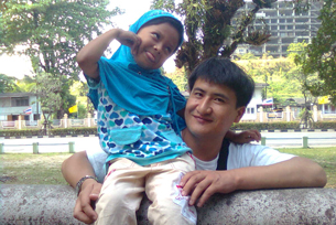 Nur Muhemmed with his daughter in Thailand in an undated photo.