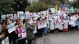 Relatives of Uyghurs detained in Xinjiang hold a protest in front of the Chinese consulate in Istanbul, Turkey, Jan. 13, 2021.
