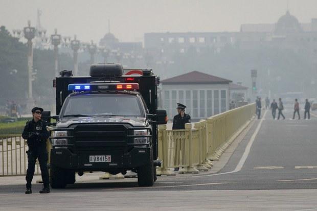 uyghur-tiananmen-guard-oct-2013.jpg