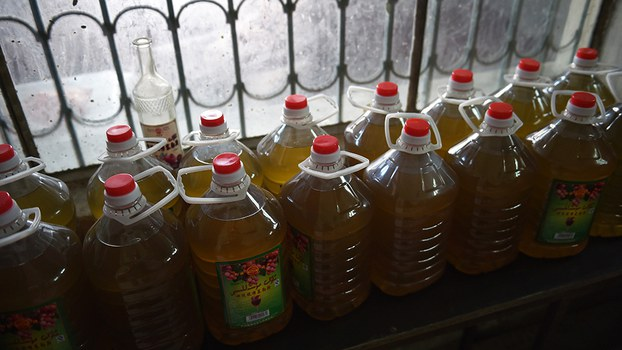 Bottles of wine line a shelf at the Awat Ruby Museles Winery in Awat, Xinjiang, in a file photo. AFP