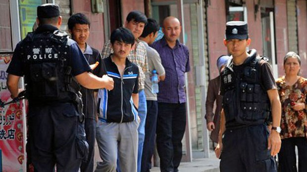 Chinese armed police patrol the area around a mosque before Friday prayers in Urumqi, capital of northwestern China's Xinjiang Uyghur Autonomous Region, in a file photo.