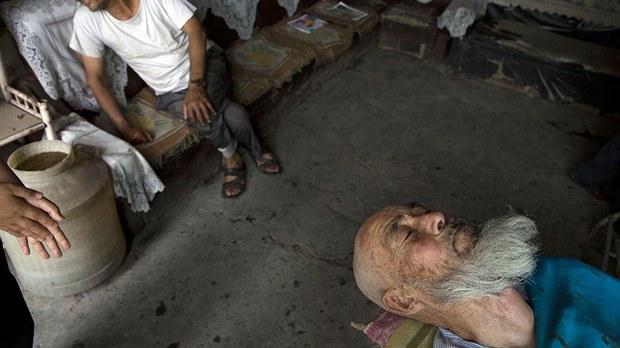 uyghur-elderly-bearded-man-july-2014.jpg