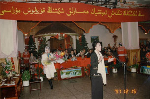Rebiya Kadeer speaking at the Rebiya Kadeer Trade Center, Dec. 15, 1997. Courtesy of the Kadeer family