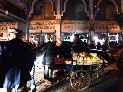 An elderly Uyghur vendor sells his wares near the Grand Bazaar in Urumqi, Sept. 17, 2014. Credit: AFP