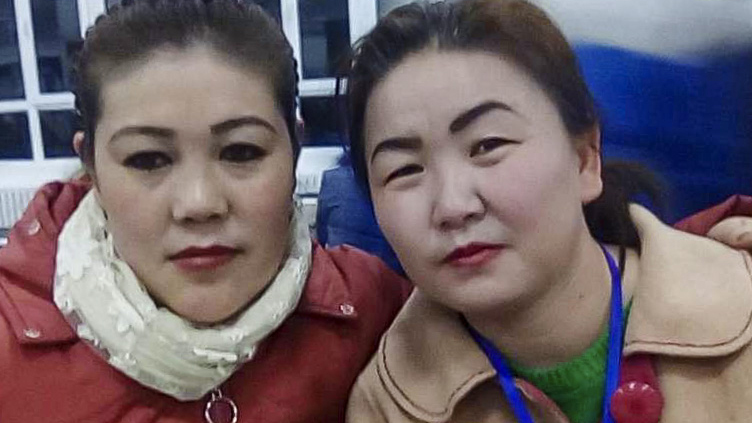 Gulzira Auelkhan (R) and a fellow worker at the Zhuowan factory in Ghulja county, in late 2018.