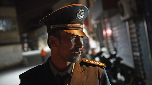 uyghur-police-officer-april-2015-crop.jpg