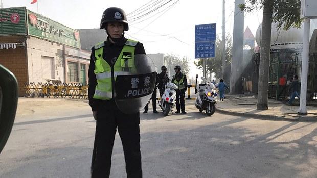 uyghur-korla-re-education-camp-police-with-shield-nov-2017.jpg