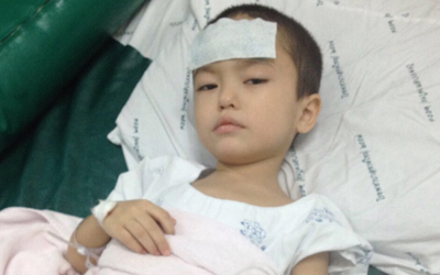 Three-year-old Abdullah is treated for tuberculosis at a hospital in southern Thailand in an undated photo.
