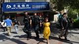 uyghur-urumqi-paramilitary-june-2013.jpg