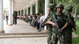 uyghur-police-qaraqash-aug-2014-crop.png