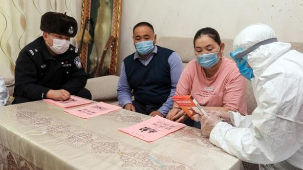 uyghur-police-visit-coronavirus-feb-2020.jpg