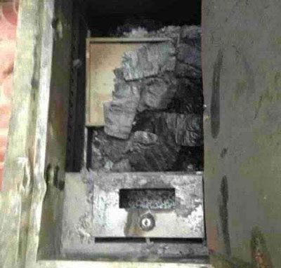 A safe containing what residents say are the charred remains of Chinese currency. Credit: RFA listener