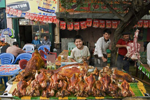 A shop sells roasted meat in Urumqi, Jan. 7, 2012.