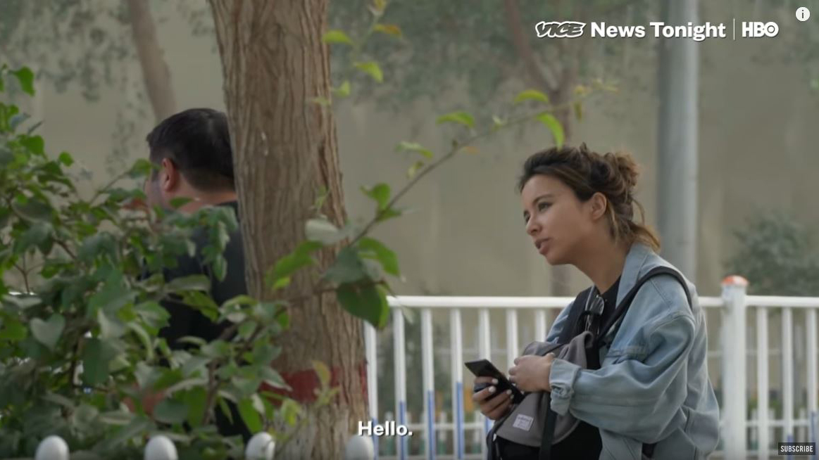 In a screen grab from her video report, Isobel Yeung confronts a man she believes to be a plainclothes officer assigned to trail her in Hotan. Credit: Vice News/HBO