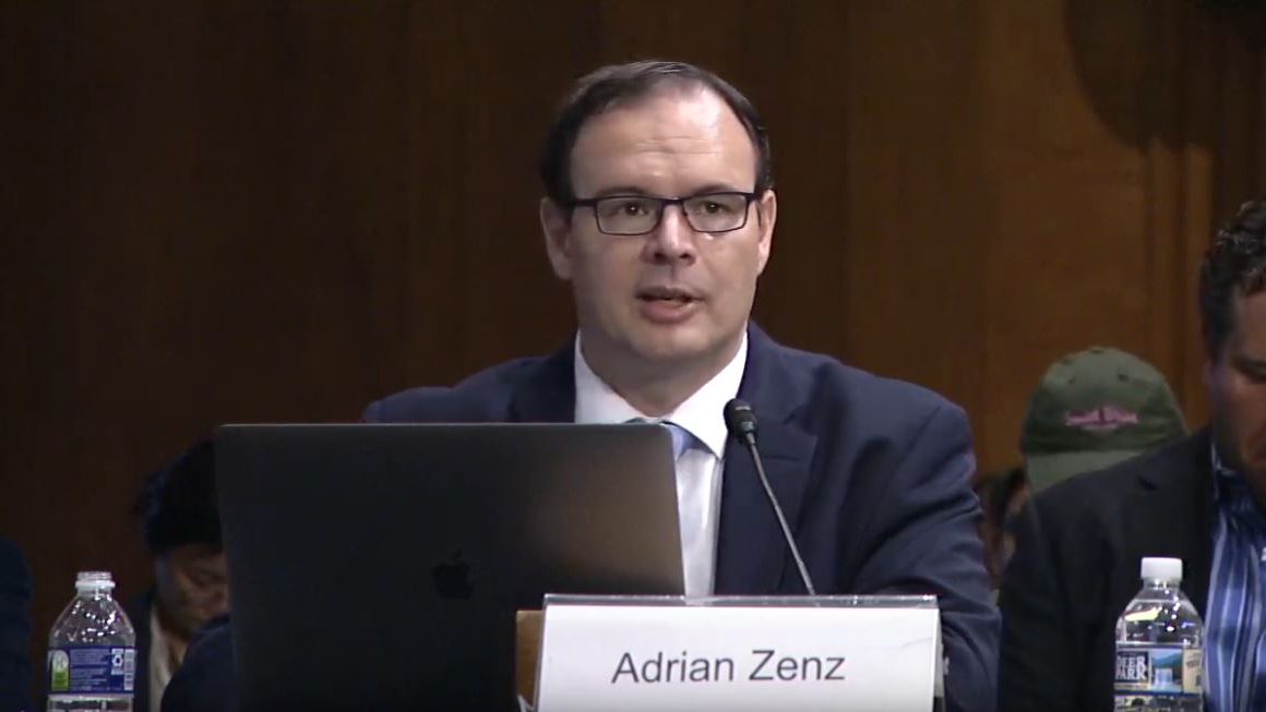 In an image taken from livestreamed video provided by the Congressional-Executive Commission on China, Adrian Zenz, an independent researcher who studies China's minority policies, speaks at a hearing in Washington on forced labor in the XUAR, Oct. 17, 2019.
