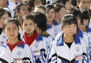 Students assemble at a bilingual middle school for Uyghur and Han students in Hotan, Xinjiang, Oct. 13, 2006.