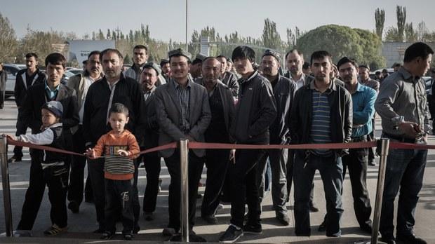 uyghur-wait-arrivals-gate-hotan-airport-april-2015-crop.jpg
