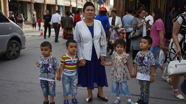 uyghur-woman-with-children-kasjgar-june-2019-crop.jpg